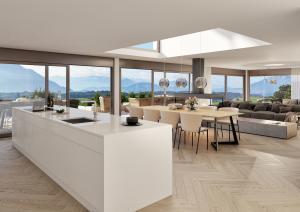3D Innenraum großes Wohnzimmer mit Kücheinsel Neubau MFH Udligenswil