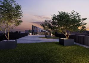 Dachterrasse mit Garten Abendlicht Visualisierung MFH Kloten